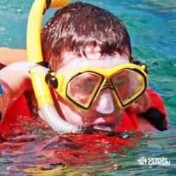 clube-de-praia-discovery-chankanaab-cozumel-cancun-homem-mergulhando-snorkel