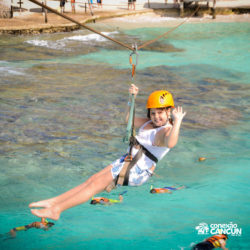 clube-de-praia-park-garrafon-dolphin-discovery-isla-mujeres-cancun-menina-na-tirolesa